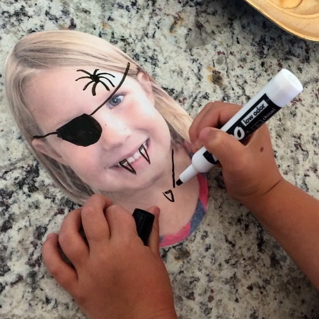 I took her picture, printed it out, covered it in contact paper, and gave her a dry erase marker. She's played with this for HOURS. I'd call that a summer activity success! ?
