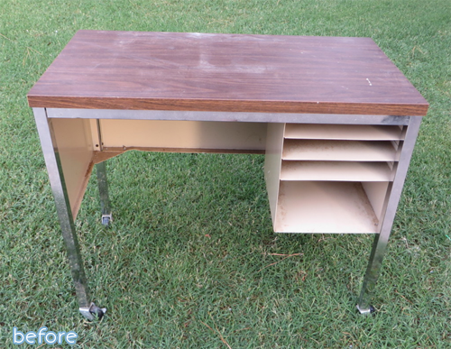 faded brown and metal desk before