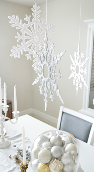 gold whie and silver christmas decor with snowflakes