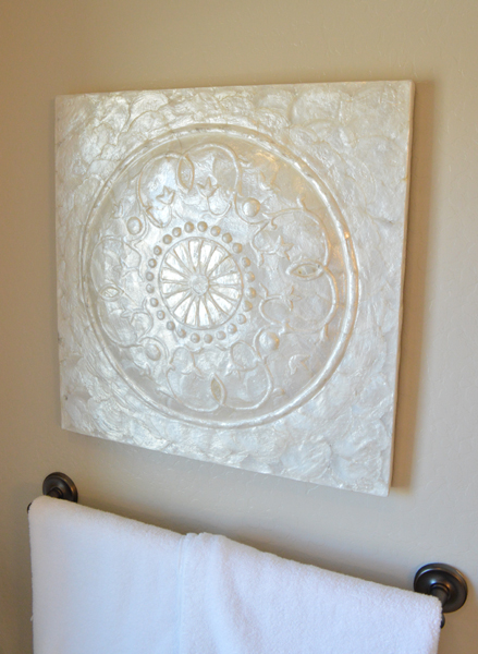 Pearlized wall medallion from HomeGoods  | betterafter.net
