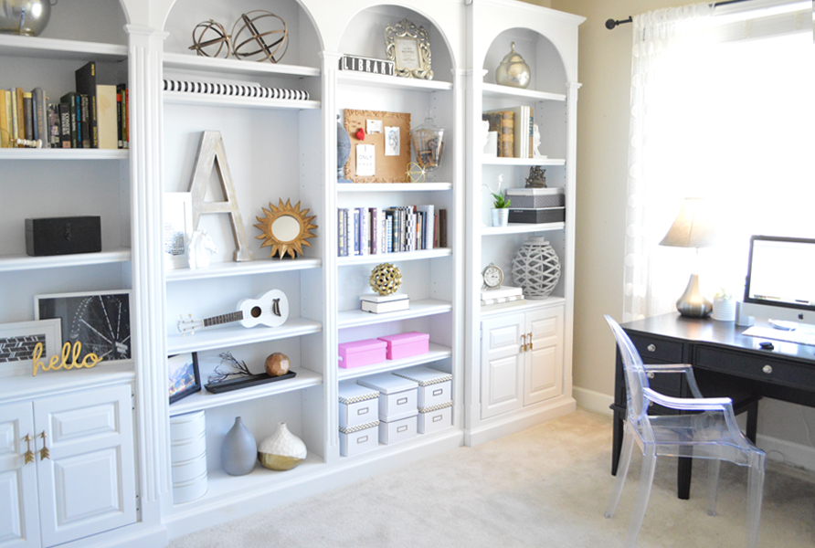 white arched office bookshelves