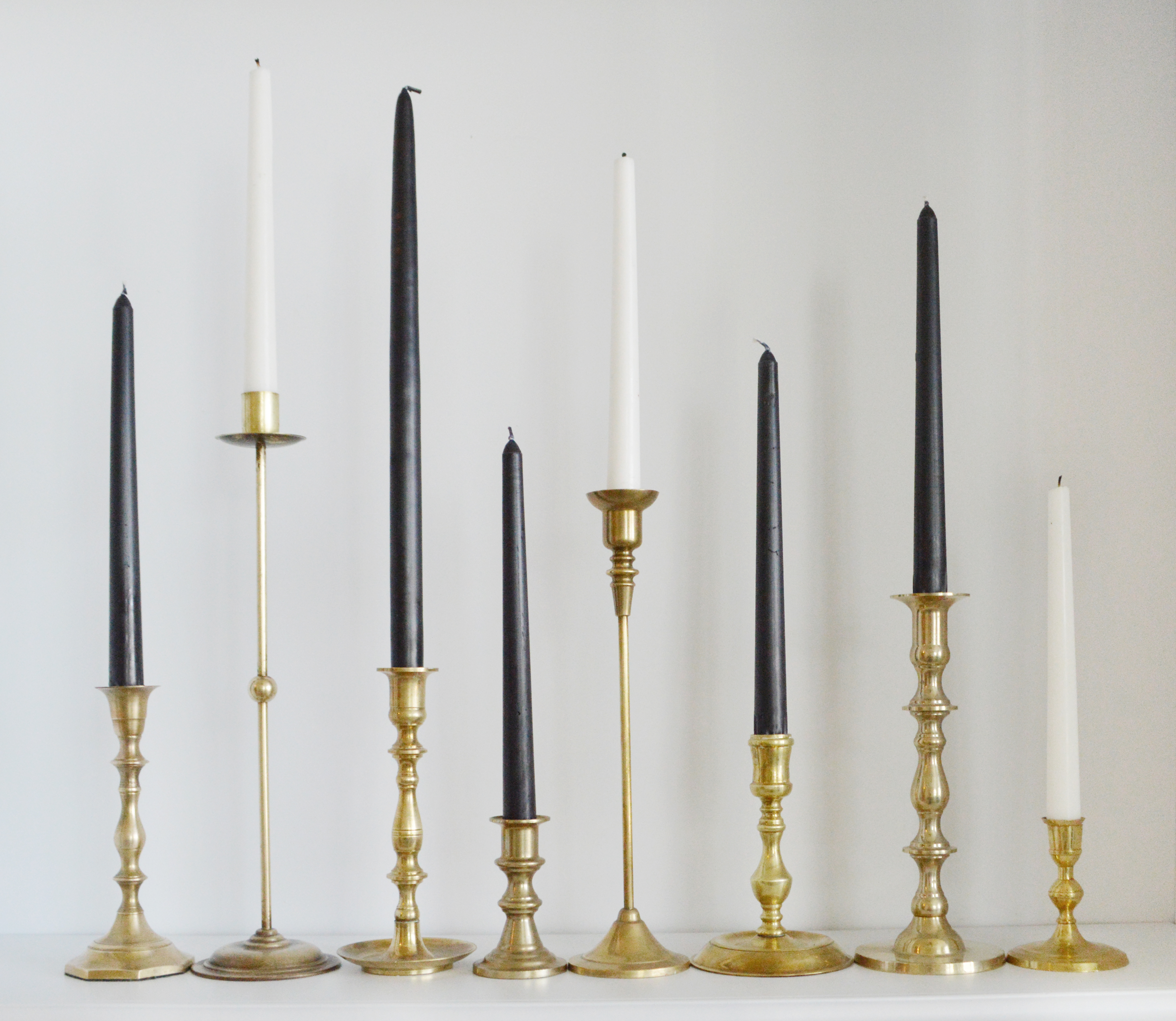 brass candlestick lined up