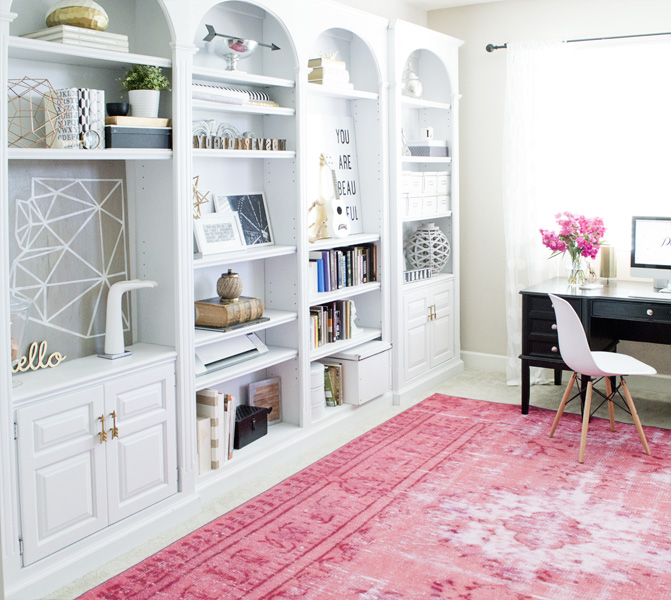 home office pink rug white shelves